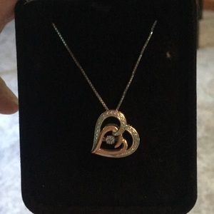 Diamonds in motion heart necklace